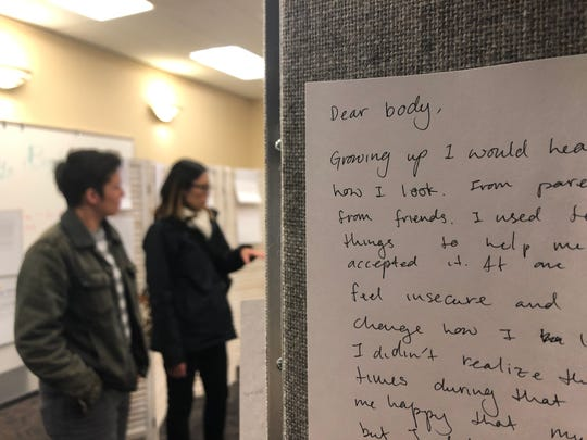 A letter written by a participant of Sexual Assault Awareness Month hangs in a display at the Iowa City Public Library on Monday, April 1, 2019.