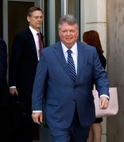 Mississippi Attorney General Jim Hood leaves the federal courthouse in Jackson, Miss., Monday, April 1, 2019. Hood wants a federal judge to order the state's largest private utility to repay more than $1 billion he says Entergy Mississippi overcharged customers.