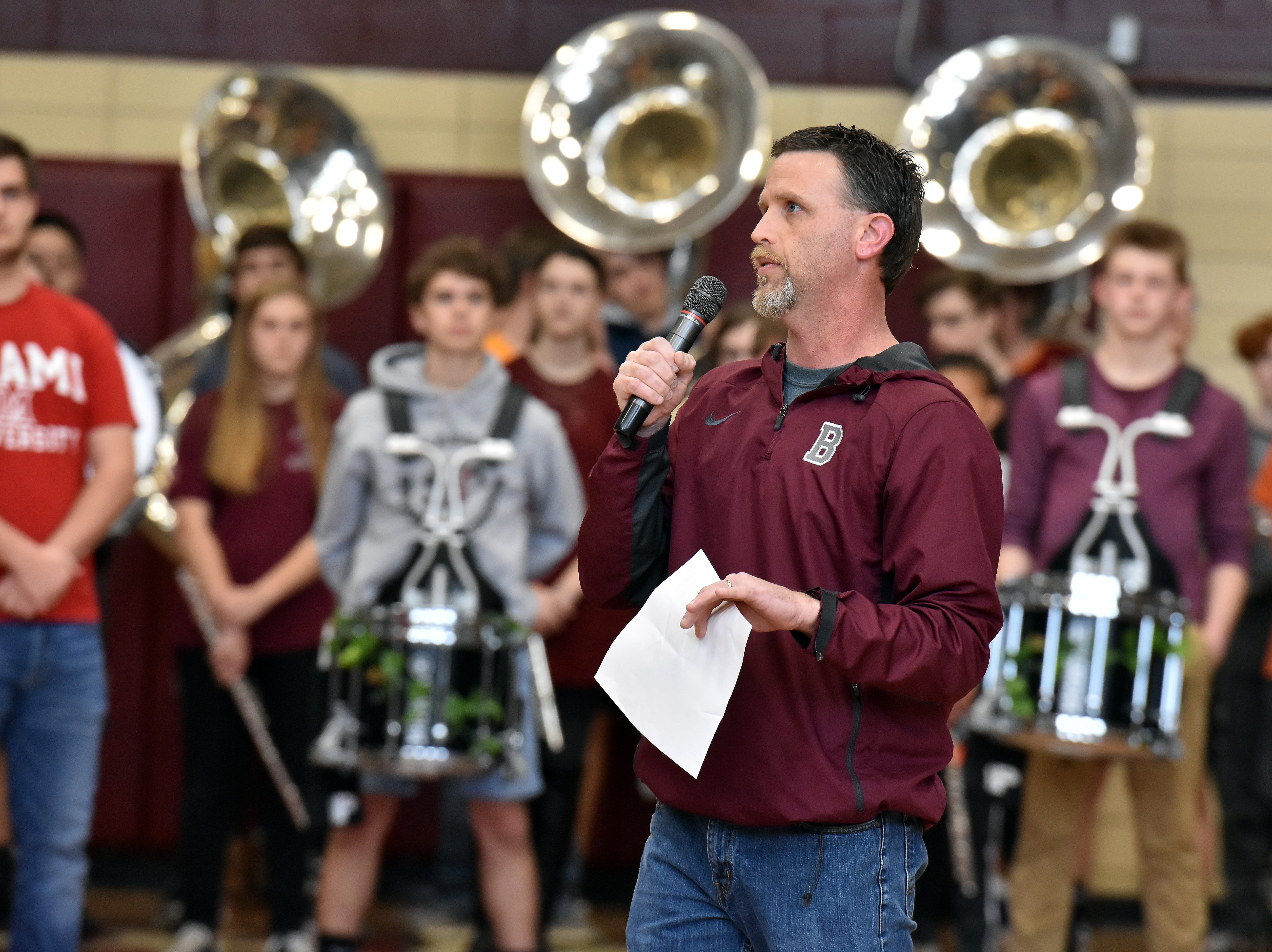 Bearden High athletic director Donald Balcom kicks off the state championship celebration for the basketball team on Friday, March 29.