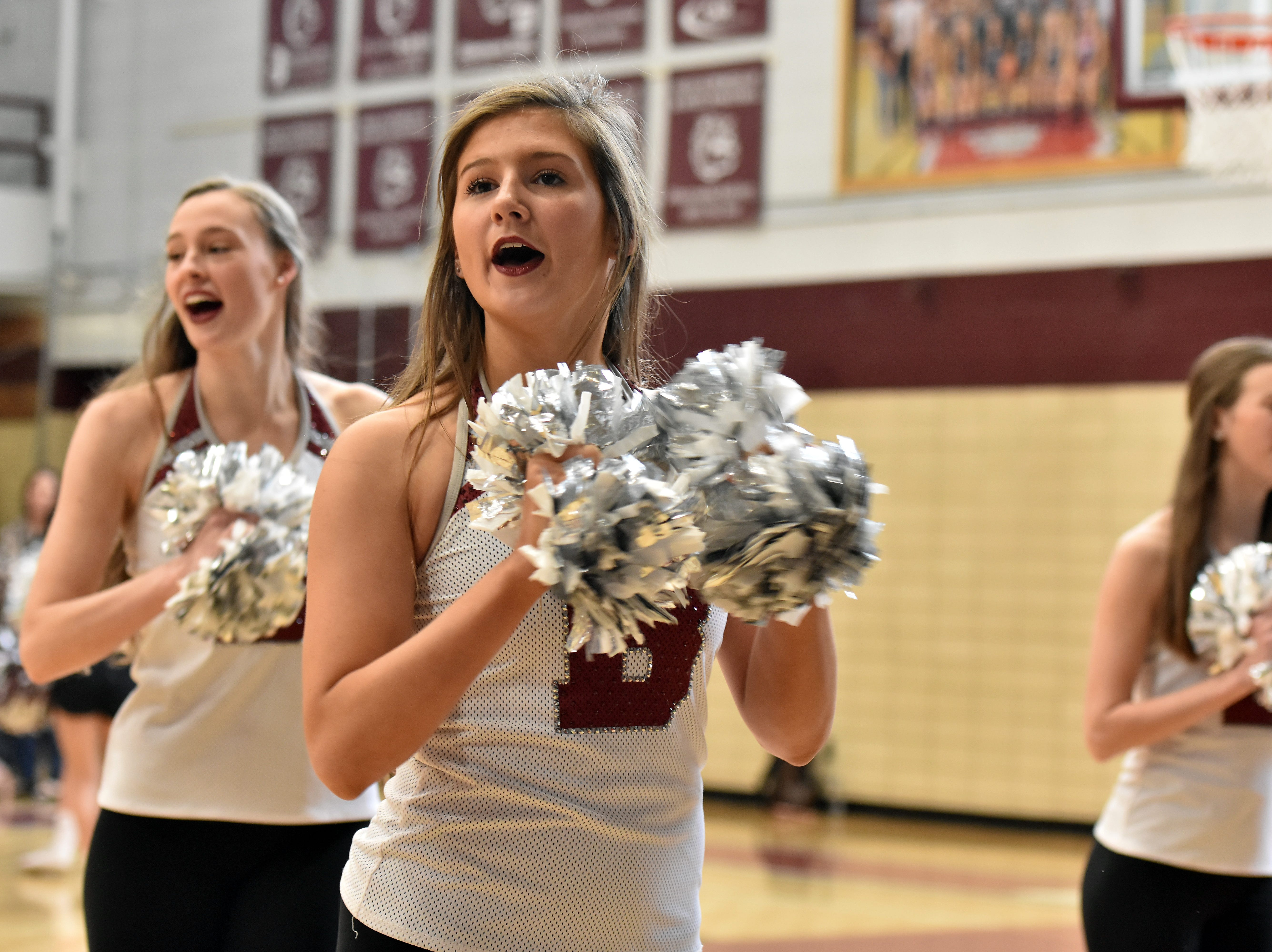 The Bearden High dance team celebrates during a pep rally in honor of the basketball team winning the state championship.