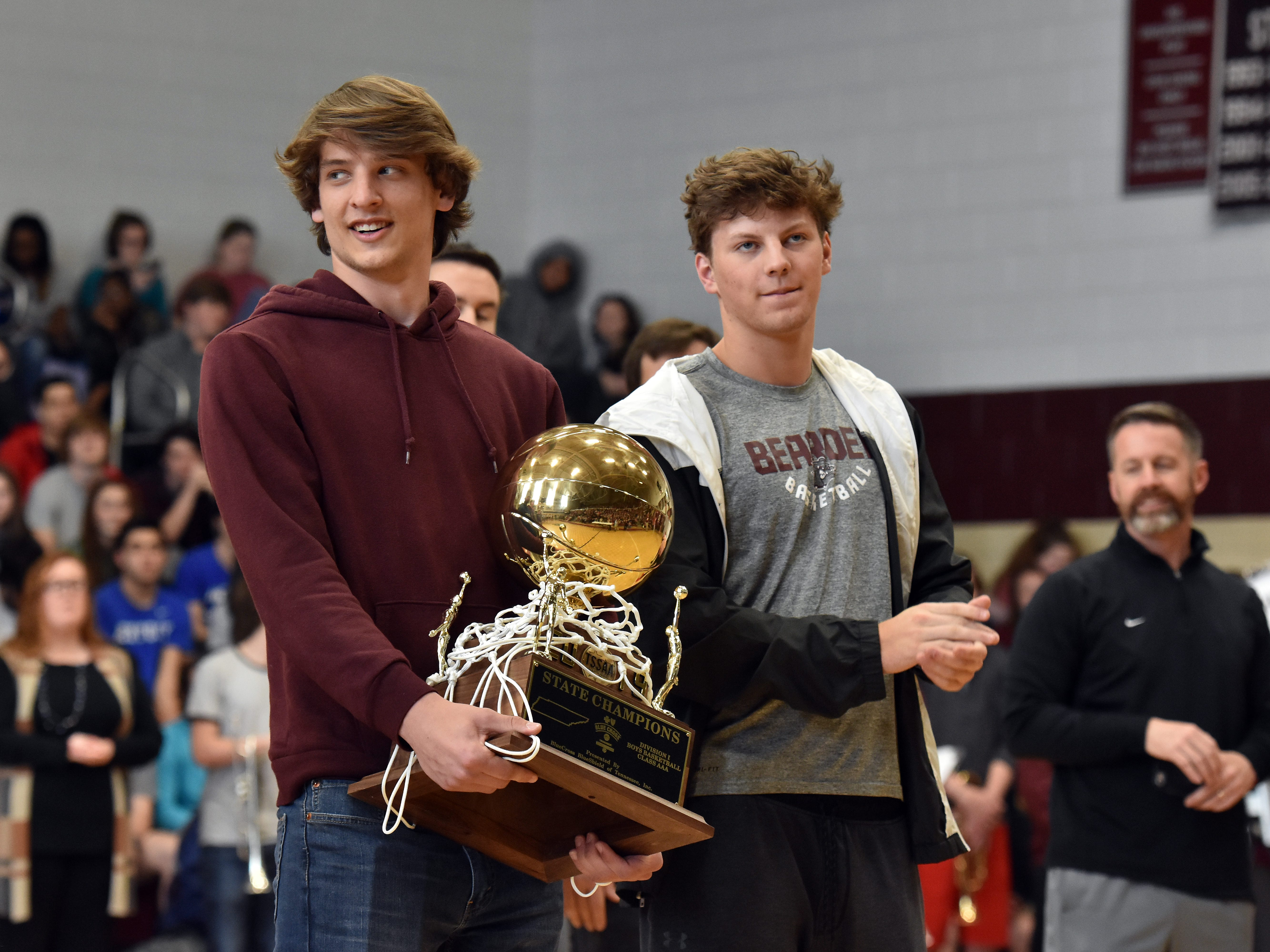 Members of the Bearden High basketball team are honored during a celebration of the school's first state championship on Friday, March 29.