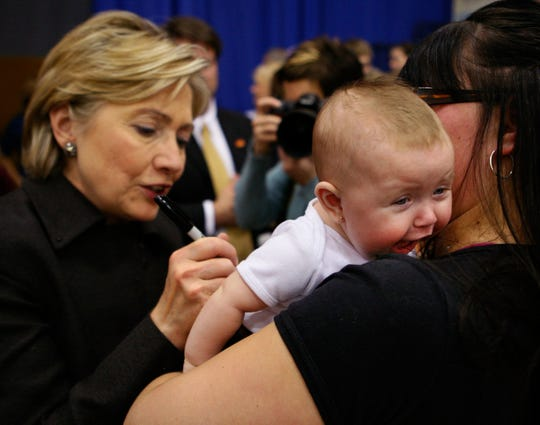 Sen. Hillary Clinton signs the shirt of a baby during a campaign event in Muscatine, Iowa, Monday, Dec. 31, 2007.
