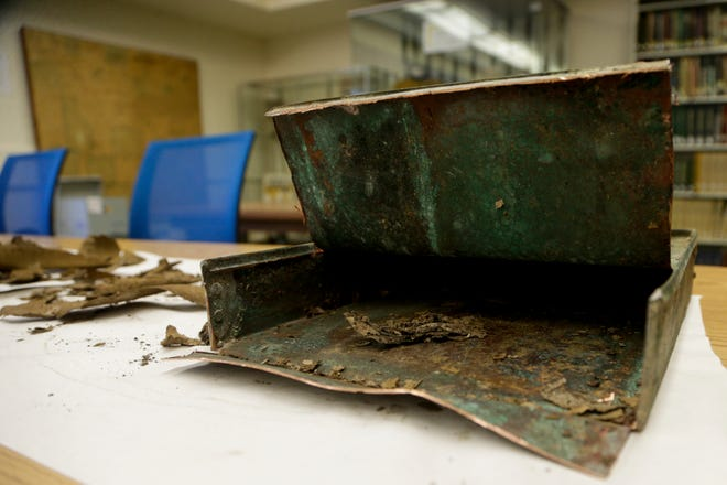 Newspaper clippings from January 26, 1931 sit on a table after being removed from a time capsule, Monday, April 1, 2019, at the Tippecanoe County Historic Association in Lafayette. The copper box,unearthed on March 28, 2019 under a boulder that commemorated the Spanish-American War in front of the Columbian Park Zoo, contained several newspaper clippings and a list of names.