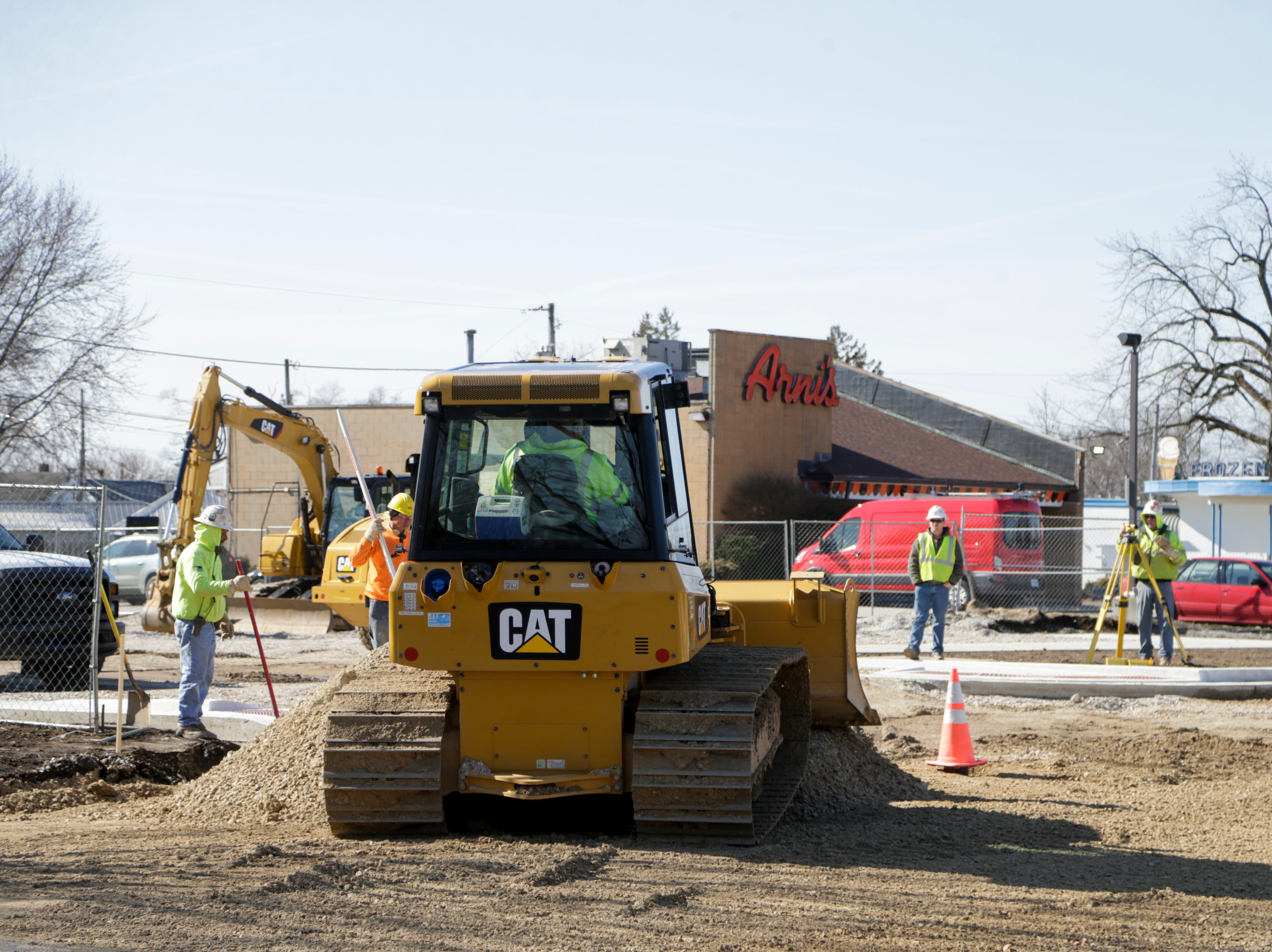 Construction crews begin to dig up the asphalt on Wallace ave. between Main st. and S 24th st., Monday, April 1, 2019, in Lafayette. The stretch of road in front of The Original Frozen Custard and Arni's is set to reopen by the end of the week, baring any weather delays. The intersection of Brice st. and S 24th st. is scheduled to reopen in 3-4 weeks.