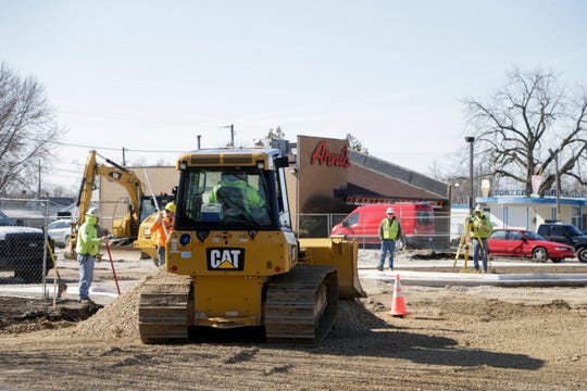 Construction crews dig the asphalt on Wallace Avenue between Main Street and South 24th Street, Monday, April 1, 2019, in Lafayette.