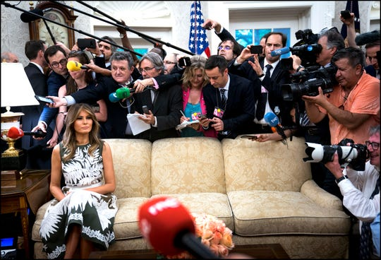 First Lady Melania Trump sits on the couch as members of the press attend the meeting between President Trump meets with Their Majesties King Felipe VI and Queen Letizia of Spain in the Oval Office, Tuesday June 19, 2018.