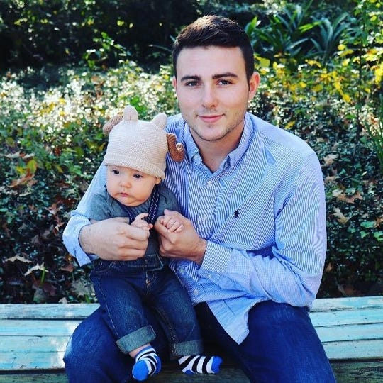 Adam Williamson, 20, with his nephew. Williamson was shot and killed at the French Colony Apartment complex on March 30, 2019.