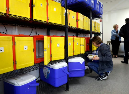 Rebecca Pessel, volunteer coordinator for Fairfield County Meals on Wheels and Older Adult Services, checks meals in hot boxes before they're delivered Monday, April 1, 2019, in Lancaster. After nearly a year of renovation work the group moved into the building in March.