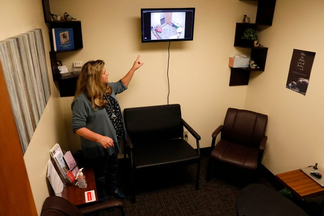 Lisa DeGeeter, executive director of the Harcum House, points a monitor parents can use to watch their children playing as parents are in an interview room at the child advocacy center in Lancaster. Harcum House provides services for children who have been abused and also provides sexual assault and rape crisis services for anyone who needs them including a 24/7 hotline.