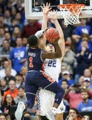 Kentucky's Reid Travis gets knocked back by Auburn's Jared Harper, who scored 26 points as the Tiger beat the Cats' 77-71 Sunday afternoon in the Elite Eight. March 31, 2019