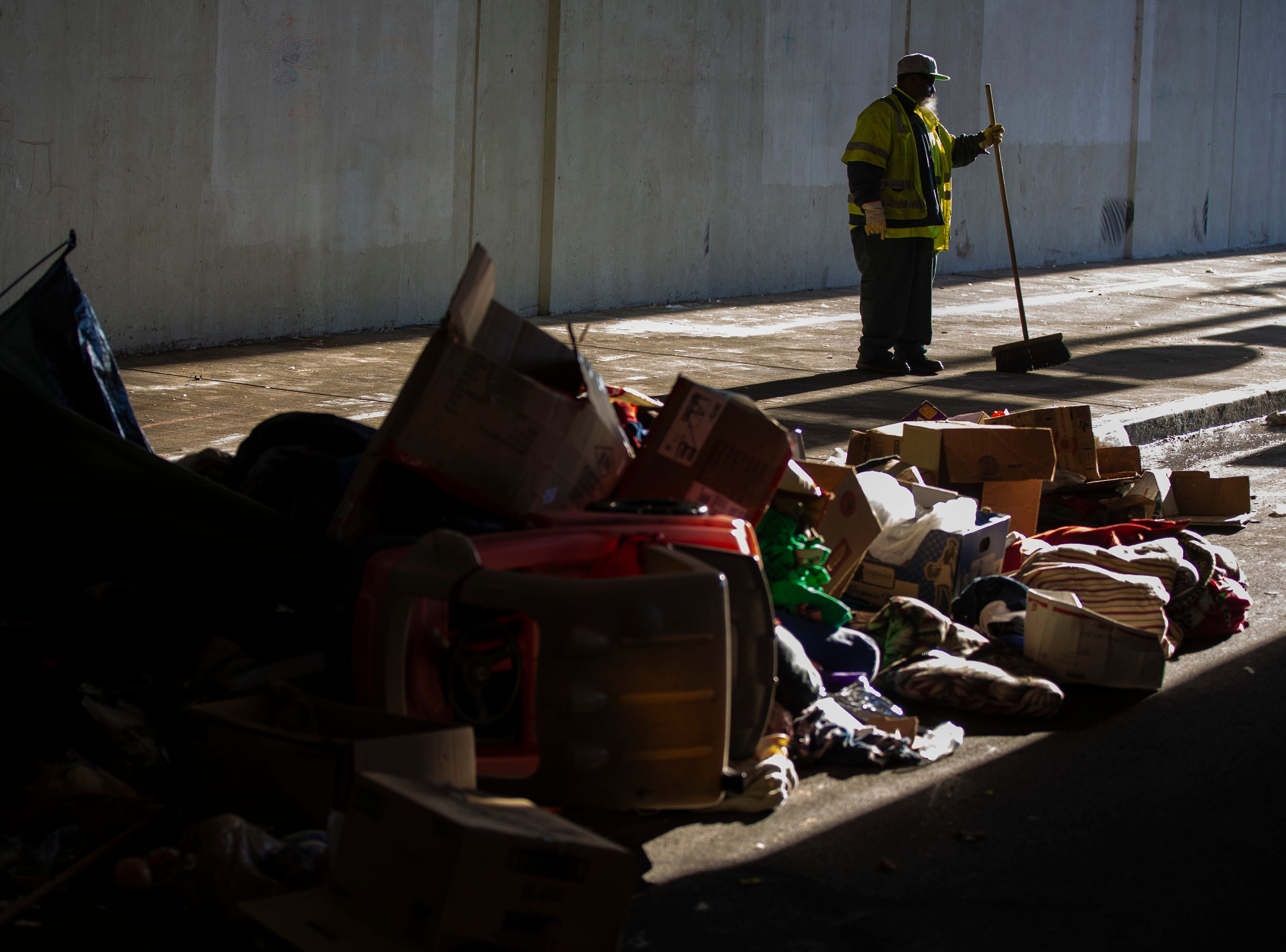 Louisville city crews clean out the homeless camp at the intersection of Jackson and Jefferson streets Monday morning.  April 1, 2019