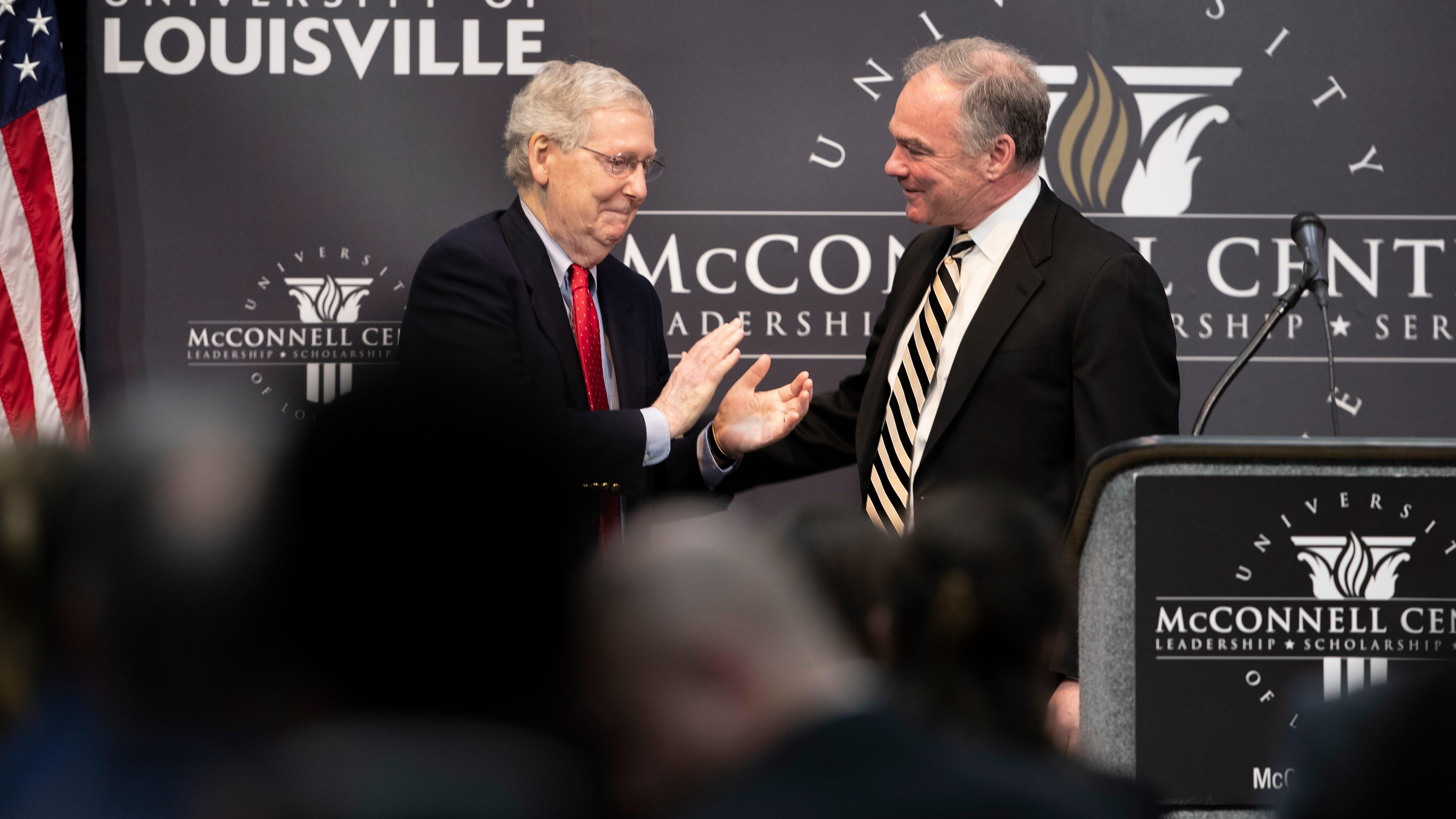 Senate Majority Leader Mitch McConnell, left, thanks Senator Tim Kaine for speaking at the University of Louisville's McConnell Center. April 1, 2019.