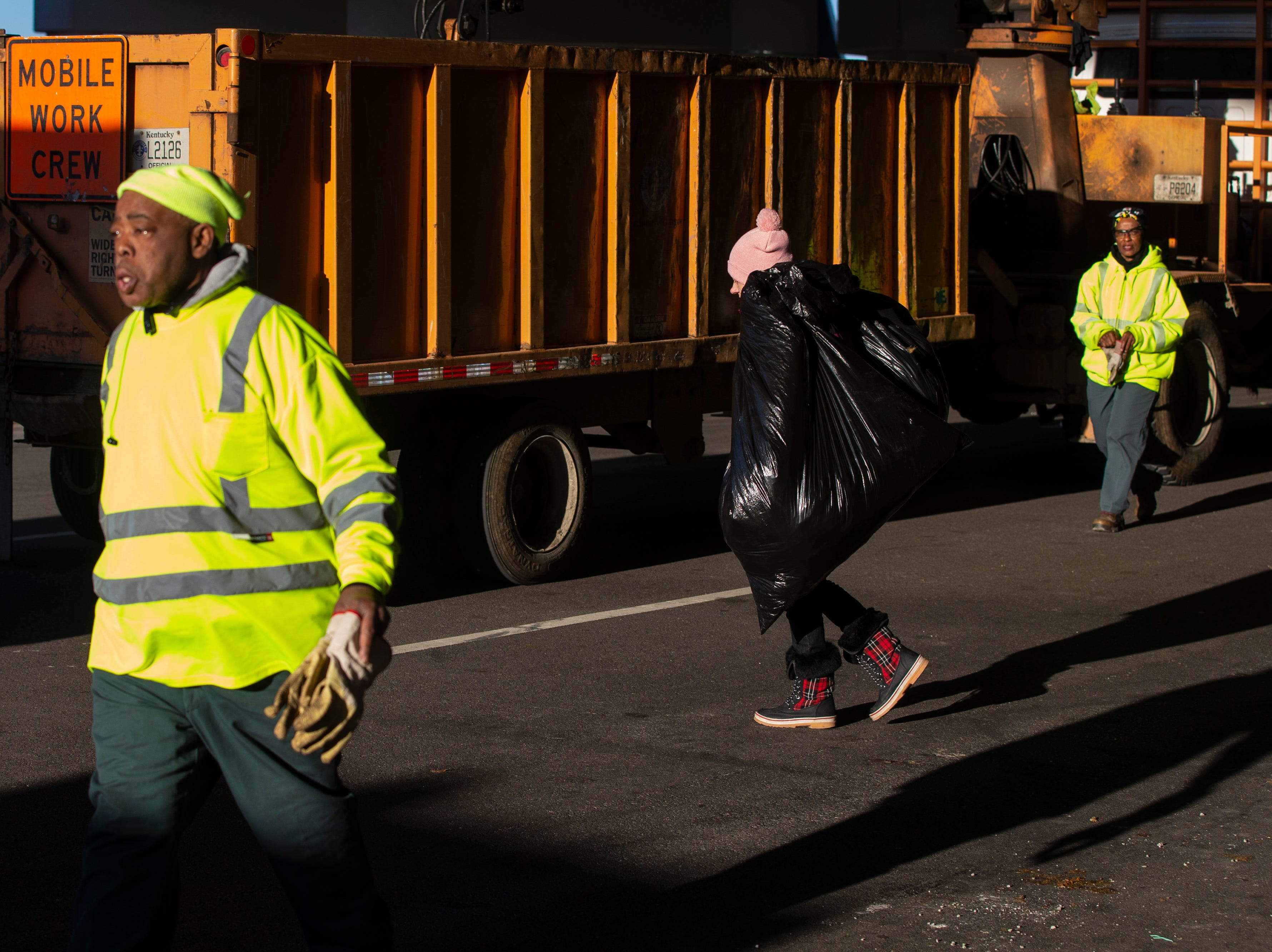 Homeless residents pack their belongings in trash bags as city crews cleaned out the homeless camp at the intersection of Jackson and Jefferson streets Monday morning. April 1, 2019