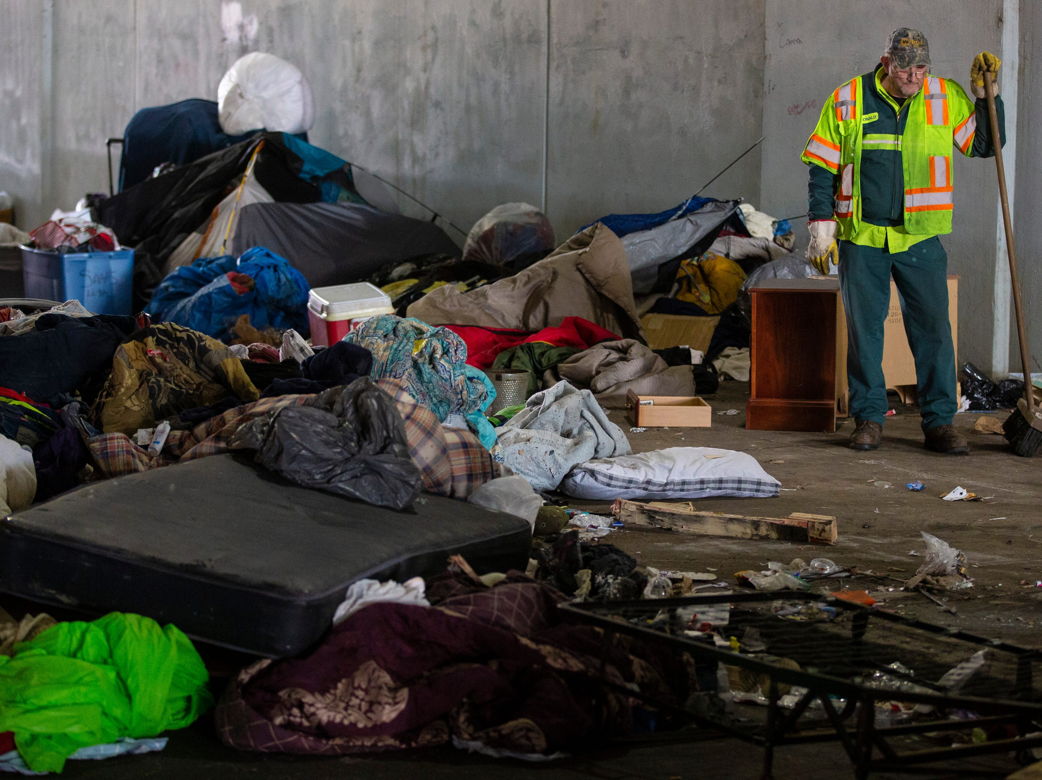 Louisville city crews cleaned out the homeless camp at the intersection of Jackson and Jefferson streets Monday morning. April 1, 2019