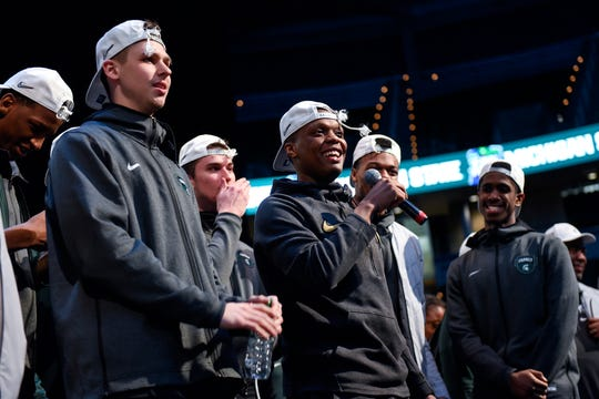 Michigan State's Cassius Winston, center, addresses the crowd during a rally after MSU's victory over Duke on Sunday, March 31, 2019, at the Breslin Center in East Lansing. The Spartans beat Duke 68-67 to reach the Final Four.