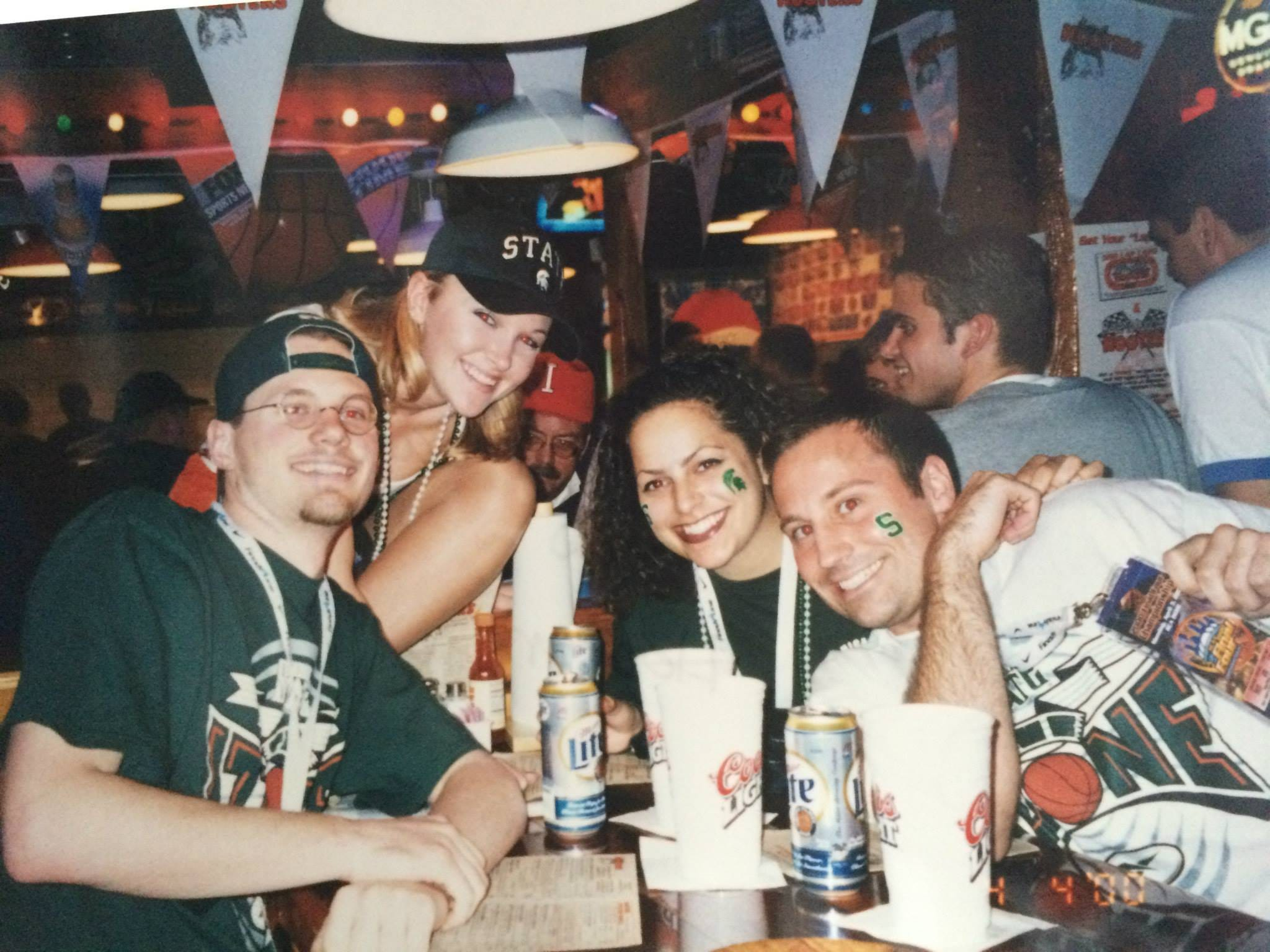 Friends Brian Wilson, left, Kathleen Torres, middle, and State Journal reporter Eric Lacy celebrate in Indianapolis before the 2000 national title game.