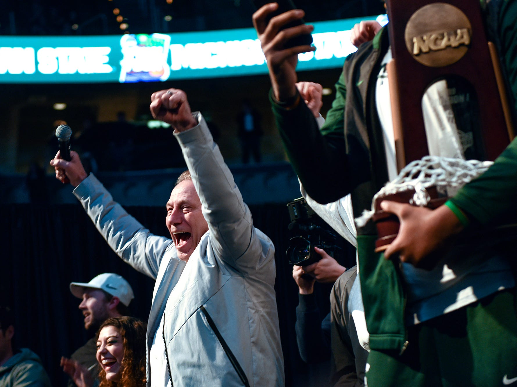 Michigan State head coach Tom Izzo celebrates with fans during a rally after MSU's victory over Duke on Sunday, March 31, 2019, at the Breslin Center in East Lansing. The Spartans beat Duke 68-67 to reach the Final Four.