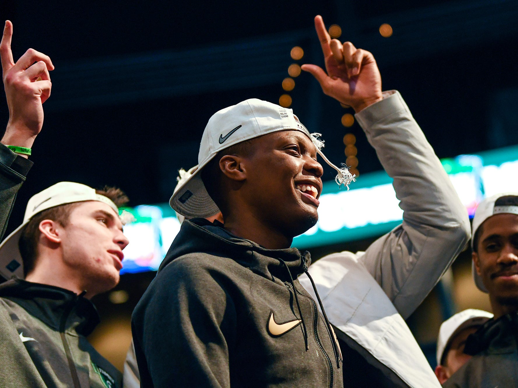 Michigan State's Cassius Winston smiles while addressing the crowd during a rally after MSU's victory over Duke on Sunday, March 31, 2019, at the Breslin Center in East Lansing. The Spartans beat Duke 68-67 to reach the Final Four.