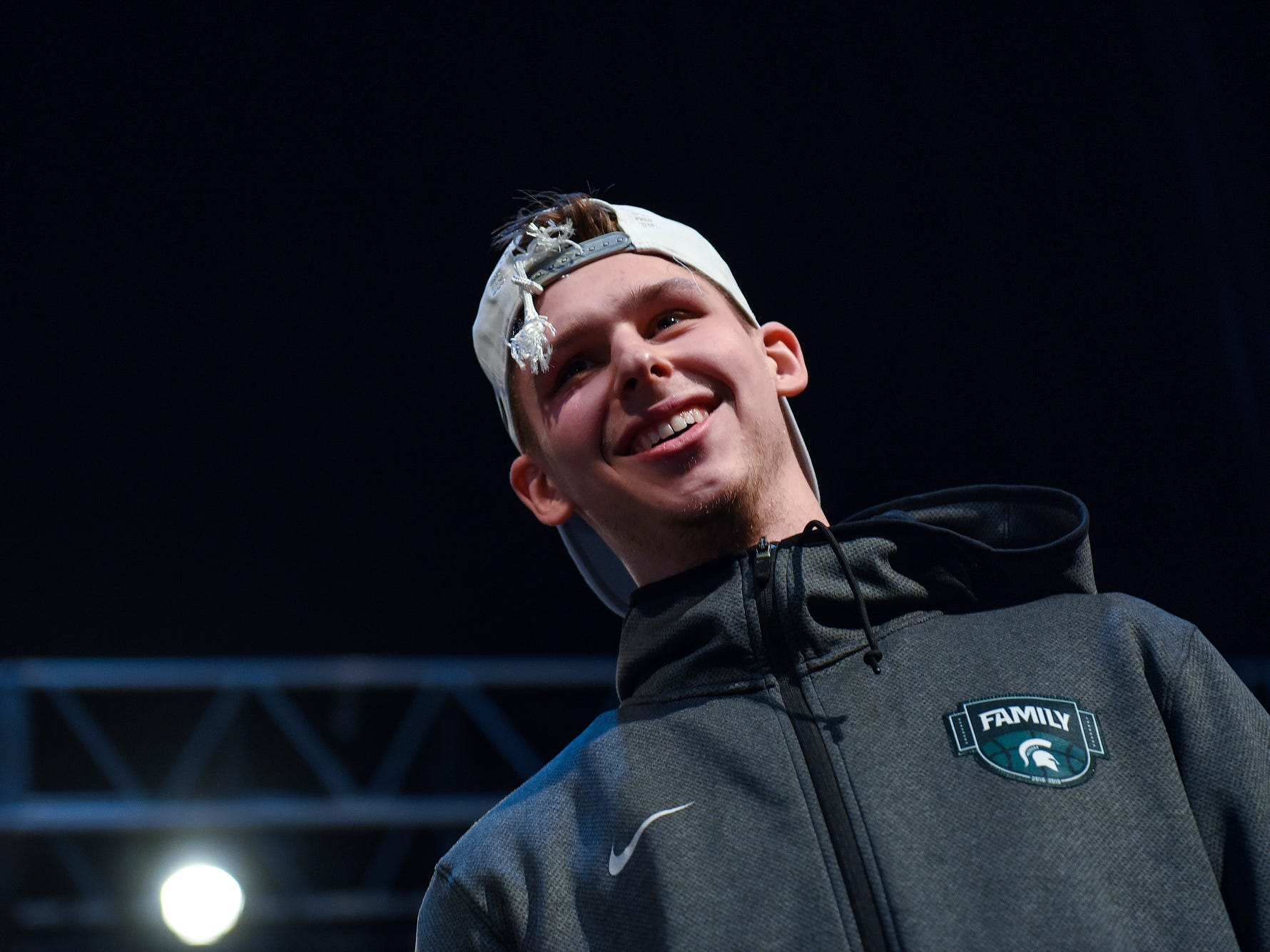 Michigan State's Matt McQuaid smiles while addressing the crowd during a rally after MSU's victory over Duke on Sunday, March 31, 2019, at the Breslin Center in East Lansing. The Spartans beat Duke 68-67 to reach the Final Four.