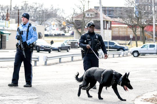Lansing Police and a tracking dog were in the area north of West Saginaw Street near Chicago Avenue after a reported shooting incident  on Monday, April 1, 2019, in Lansing.