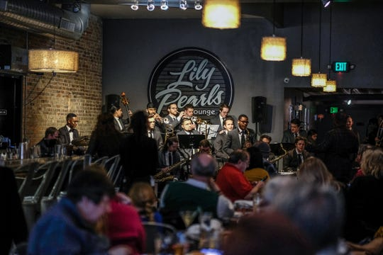 Diners listen to jazz from the MSU Jazz Orchestra Sunday, March 31, 2019 in Lily Pearls Lounge at Lula's Louisiana Cookhouse in Owosso.