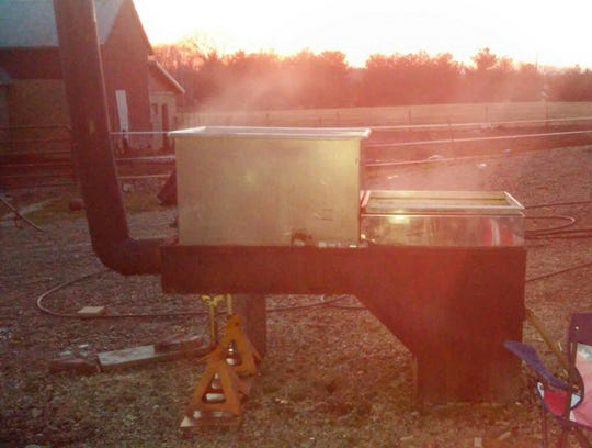Lovina's sons-in-law Tim and Mose have cooked many gallons of sap into maple syrup this spring.