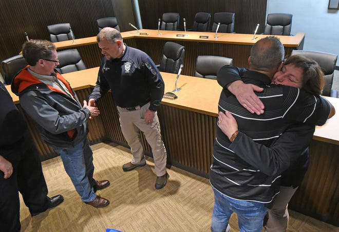 Detectives Bill Bushong and Angie Eichinger accept congratulations Monday afternoon during their retirement party.