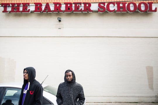 April 01, 2019 - De'Angelo Ivory, left, and Coryante Threlkeld, right, wait outside of The Barber School on Jackson Ave. after seeing signs on the door stating that the school was now closed. The school with campuses in Memphis and Jackson abruptly closed Monday morning, stranding about 180 students and leaving 17 people without a job.