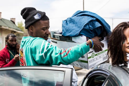 April 01, 2019 - Milton Garrett loads his school materials and belongings into a car after hearing that The Barber School was now closed. The school with campuses in Memphis and Jackson abruptly closed Monday morning, stranding about 180 students and leaving 17 people without a job.