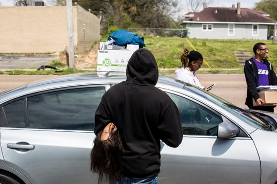 April 01, 2019 - LaXavier Jenkins, center, carries away his belongings including a mannequin head from The Barber School on Jackson Ave. after it closed. The school with campuses in Memphis and Jackson abruptly closed Monday morning, stranding about 180 students and leaving 17 people without a job.