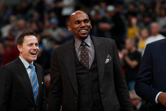 Memphis Grizzlies assistant coach Jerry Stackhouse in the first half of an NBA basketball game Monday, Dec. 10, 2018, in Denver. (AP Photo/David Zalubowski)