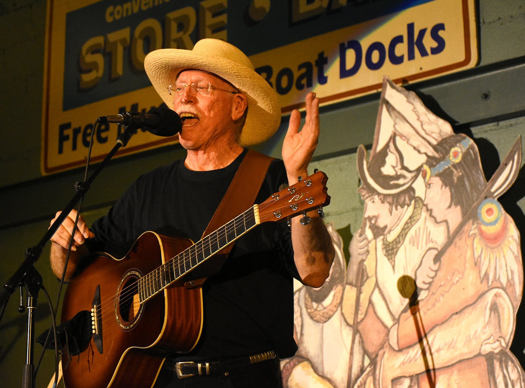 J. Robert tells the story behind one of his songs. The Florida Songwriter Showcase brought original Sunshine State music to the Margood Harbor Park stage in Goodland on Friday evening.