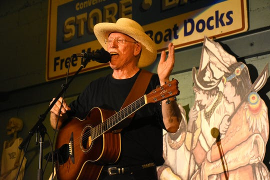 J. Robert tells the story behind one of his songs. The Florida Songwriter Showcase brings original Sunshine State music to the Margood Harbor Park stage in Goodland.