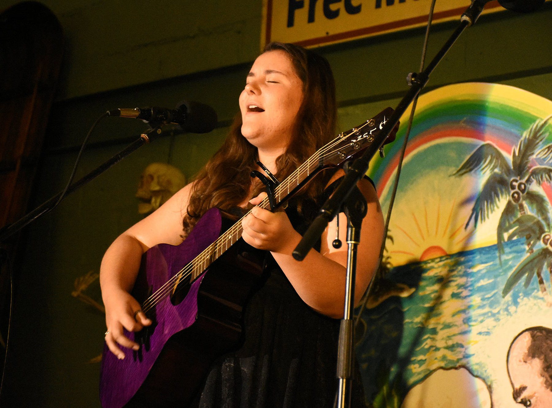Charlie Pace sings one of her original compositions. J. Robert's Florida Songwriter Showcase brought original Sunshine State music to the Margood Harbor Park stage in Goodland on Friday evening.