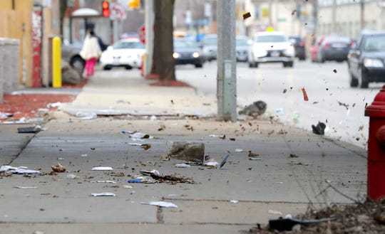 Litter is blown by the wind near West Hickory Street and West Fond du Lac Avenue in Milwaukee on Monday. As of Monday, anyone caught littering in the city will now face a $500 fine. The measure to increase littering fines was approved by the Common Council in February. Littering fines previously started at $25 for the first offense and $50 for subsequent offenses.