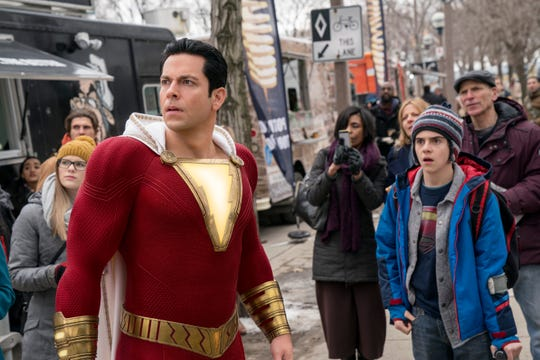 "Billy Batson becomes a superhero (Zachary Levi, left, with Jack Dylan Grazer) with just one word in ""Shazam!"""