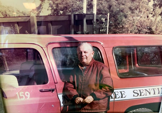 Joe Booz, a Milwaukee Journal circulation manager, is shown with his delivery truck. He worked for the company from 1948 to 1986, and during that time interacted with many boys and girls who had paper routes in Whitefish Bay.
