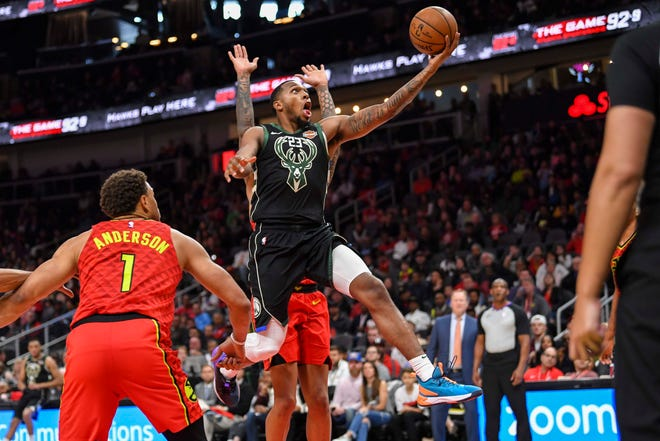 Mar 31, 2019; Atlanta, GA, USA; Milwaukee Bucks guard Sterling Brown (23) drives to the basket against the Atlanta Hawks during the second half at State Farm Arena. Mandatory Credit: Dale Zanine-USA TODAY Sports