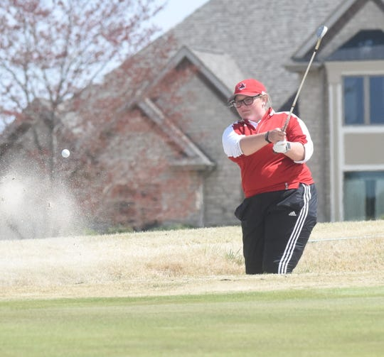 Brittani Casement hits a shot out of the bunker on the ninth hole Monday at Big Creek Golf & Country Club during the Henderson State Women's Invitational.
