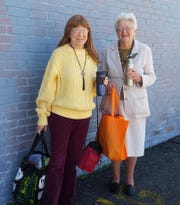 Area residents Pam Phillips (left) and Alice Hurley demonstrate their reduce and reuse practices.