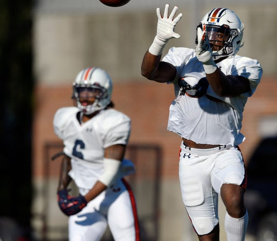 Auburn cornerback Noah Igbinoghene goes through drills during practice on Wednesday, March 27, 2019 in Auburn, Ala.