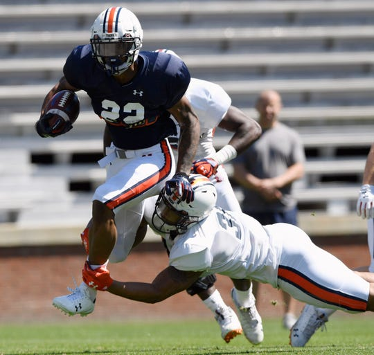 Auburn's Harold Joiner (22) runs past Michael Harris (31) during spring practice on Saturday, March 30, 2019, in Auburn, Ala.