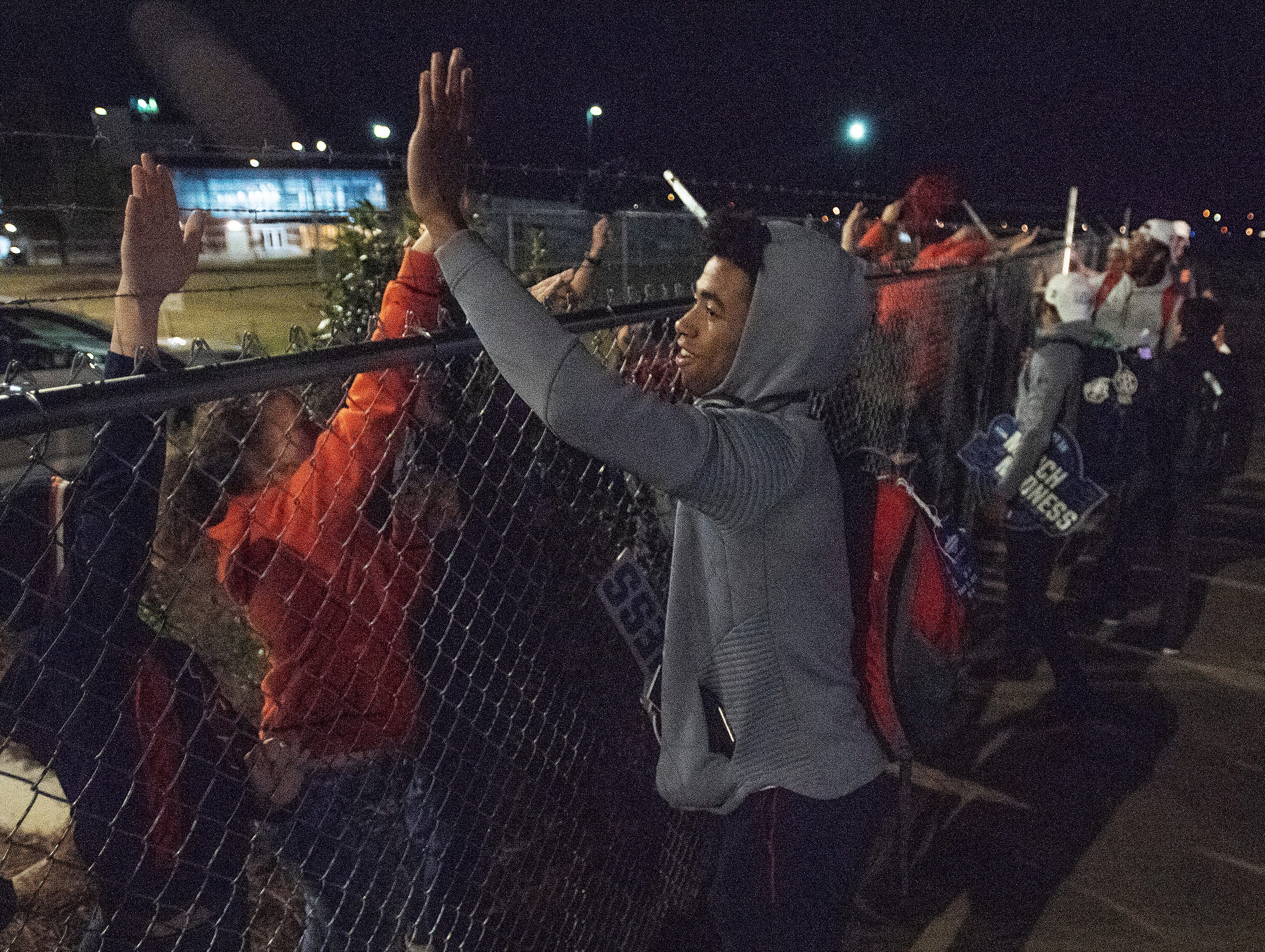 Players greet fans as the Auburn men's basketball team arrives at the Montgomery, Ala., airport on Sunday evening March 31, 2019 after defeating Kentucky in Kansas City to advance to the NCAA Basketball Final Four next weekend.