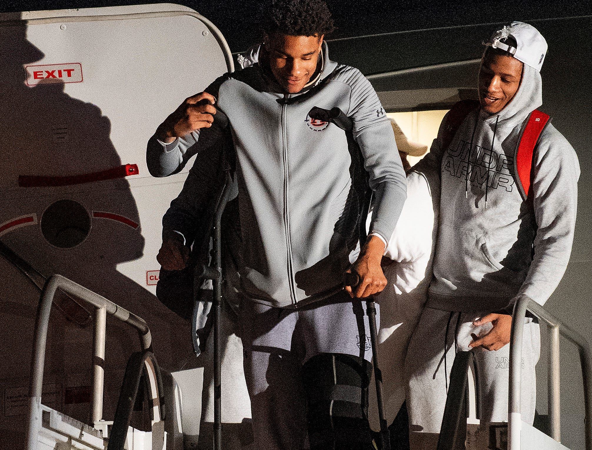 Injured player Chuma Okeke makes his way from the jet as the Auburn men's basketball team arrives at the Montgomery, Ala., airport on Sunday evening March 31, 2019 after defeating Kentucky in Kansas City to advance to the NCAA Basketball Final Four next weekend.
