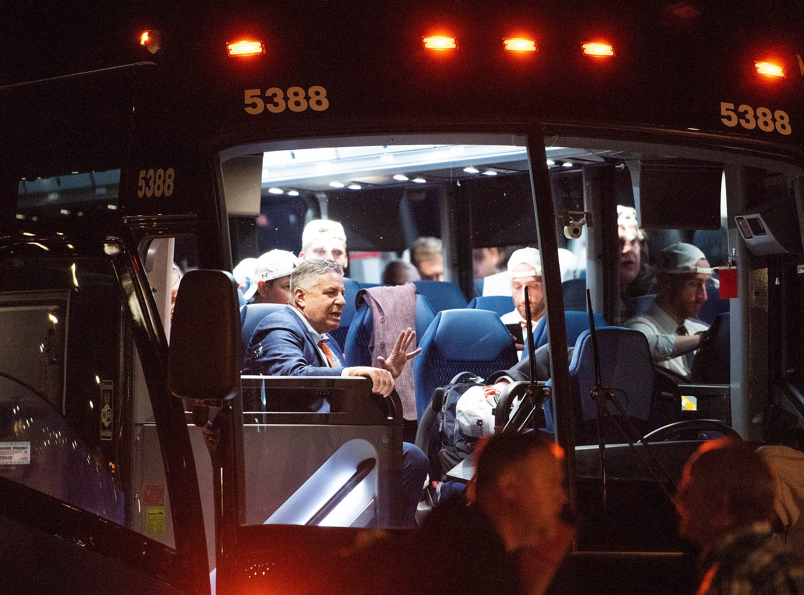 Head coach Bruce Pearl and the Auburn men's basketball team load on buses after they arrive at the Montgomery, Ala., airport on Sunday evening March 31, 2019 after defeating Kentucky in Kansas City to advance to the NCAA Basketball Final Four next weekend.