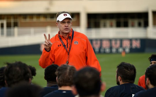 Auburn coach Gus Malzahn talks to his team after practice on Wednesday, March 20, 2019 in Auburn, Ala.
