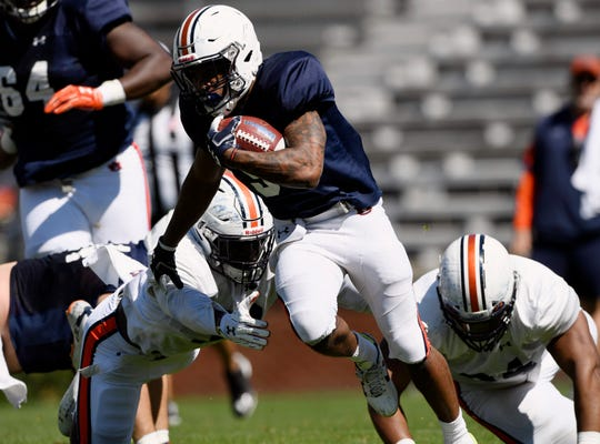 Auburn's Kam Martin runs during a scrimmage on Saturday, March 30, 2019 in Auburn, Ala.