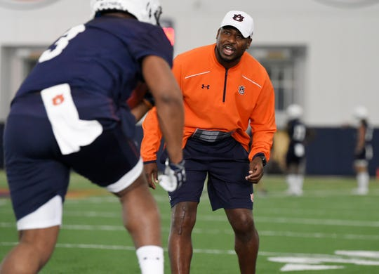 Auburn running backs coach Cadillac Williams coaches D.J. Williams (3) during spring practice on March 18, 2019 in Auburn, Ala.