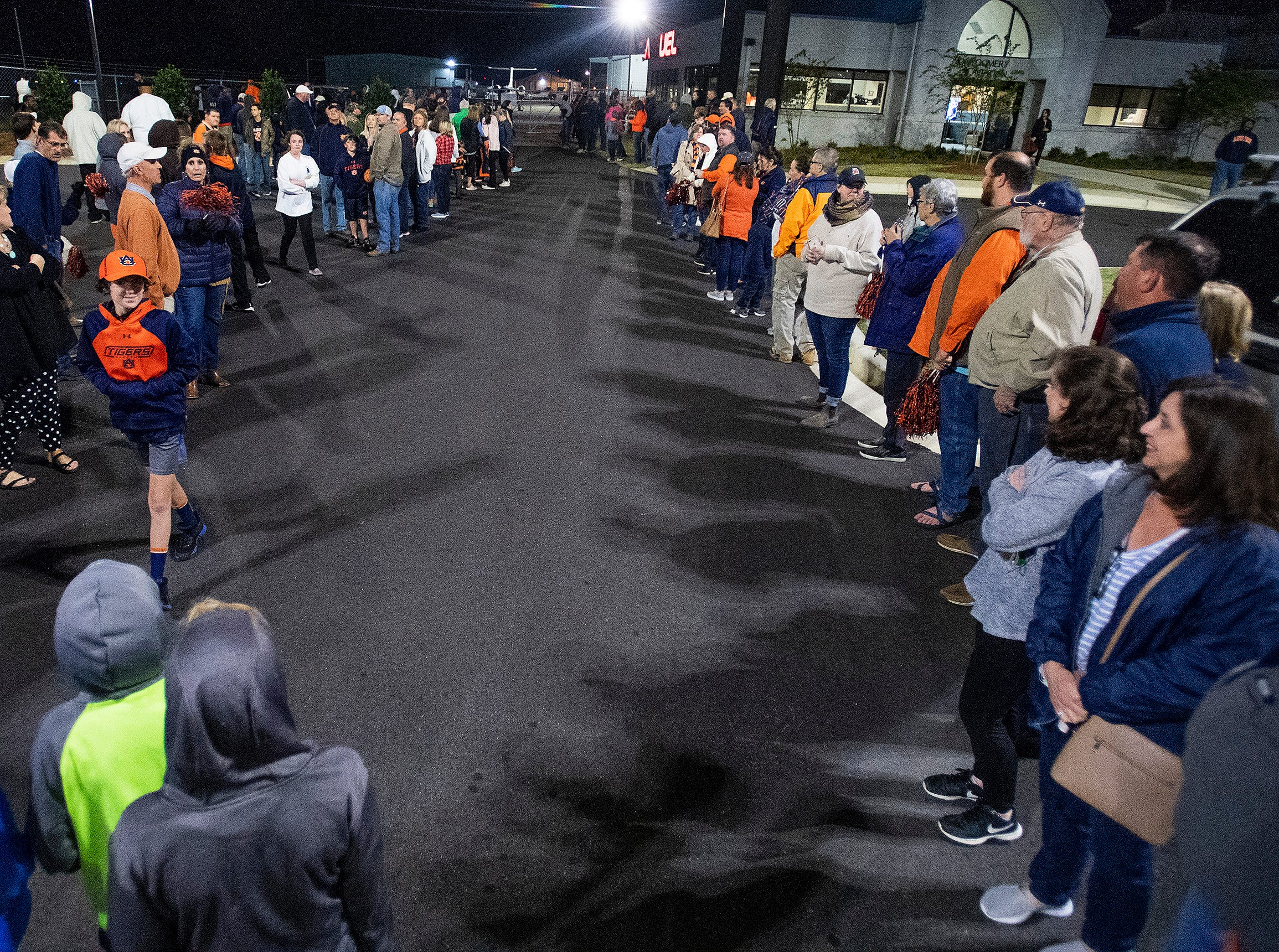 Fans line the way as the Auburn men's basketball team arrives at the Montgomery, Ala., airport on Sunday evening March 31, 2019 after defeating Kentucky in Kansas City to advance to the NCAA Basketball Final Four next weekend.