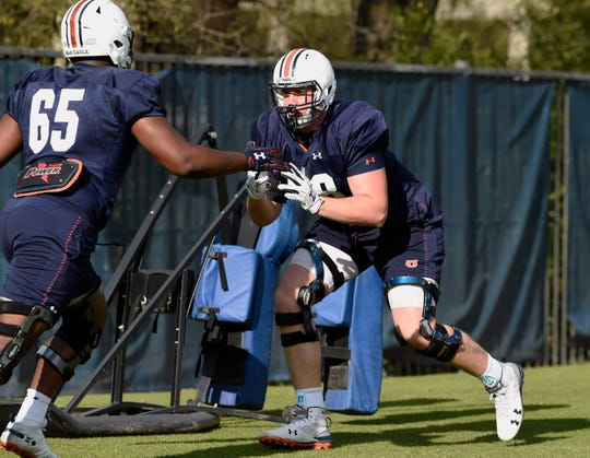 Auburn offensive linemen Austin Troxell (68) and Alec Jackson (65) go through drills during practice on Monday, March 25, 2019 in Auburn, Ala.